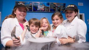 Photo of the five Ice-Cream Lab children in their white coats and baseball caps.
