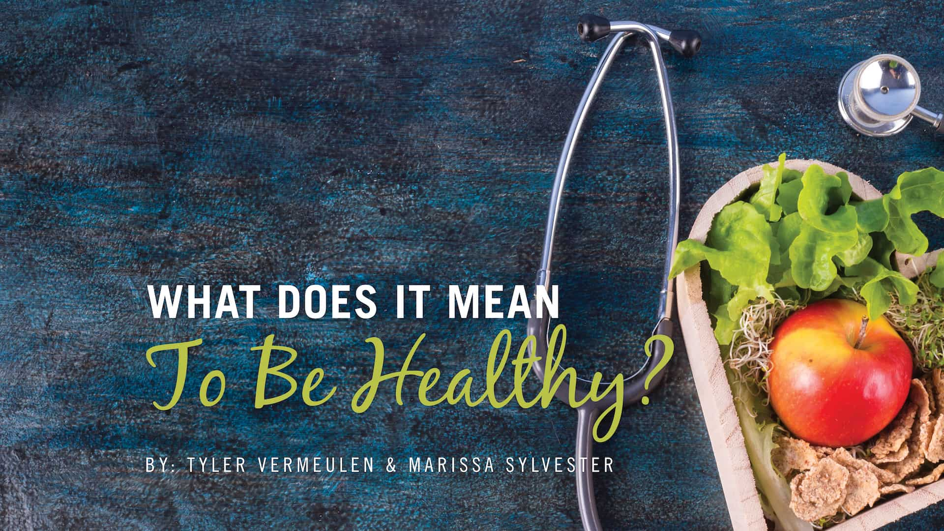 A stethoscope is curled around the heart shaped basket with an apple and a salad in it